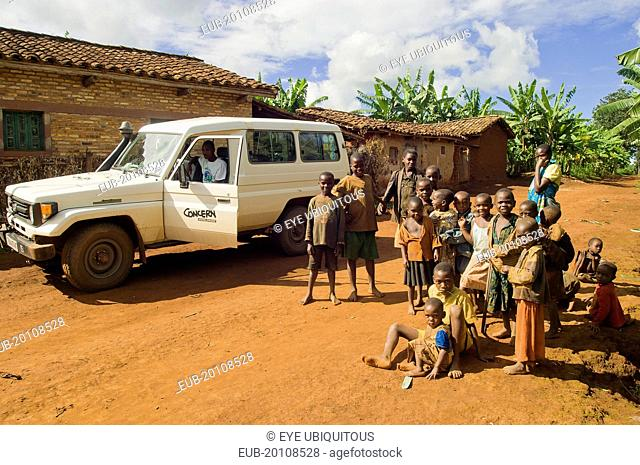 Group of children on road beside a development project vehicle