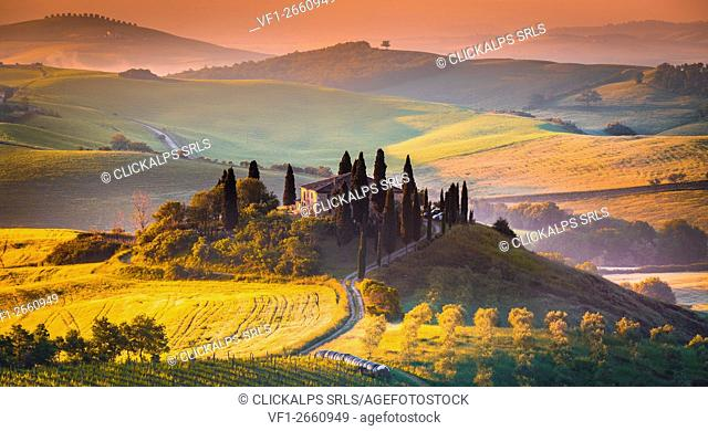 Podere Belvedere, San Quirico d'Orcia, Tuscany, Italy. Sunrise over the farmhouse and the hills
