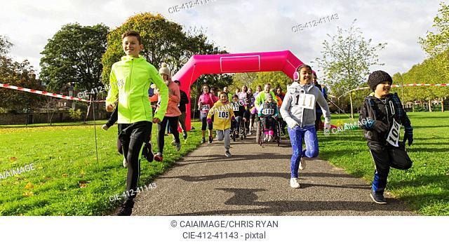 Kids running at charity run in sunny park