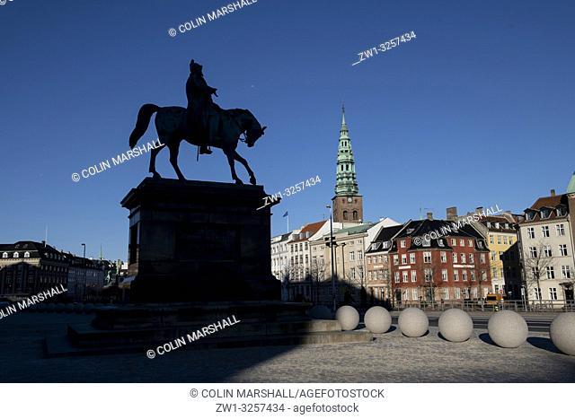 Equestrian statue silhouette of Christian VII, with spire of St Kunsthallen Nikolaj Church, Christiansborg Palace, Copenhagen, Denmark