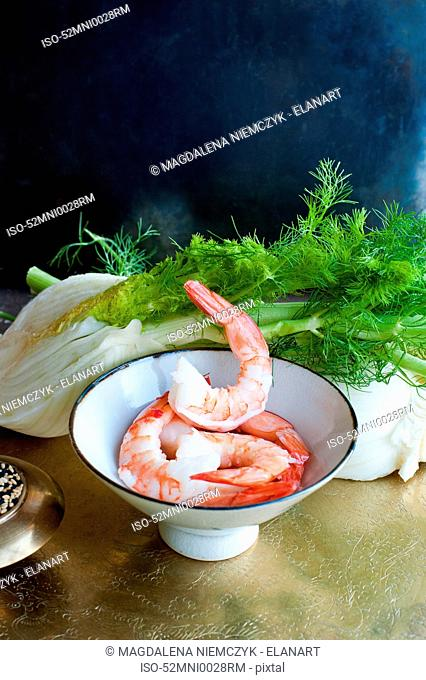 Bowl of prawns and herbs