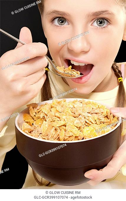 Portrait of a girl eating corn flakes