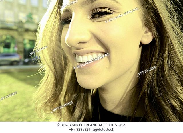 happy woman with toothy smile, in Munich, Germany