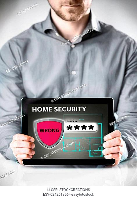 Man Holding Tablet with Home Security Display