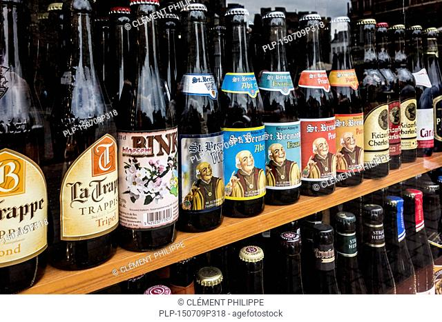 Belgian beers for sale in display window of liquor store in Belgium