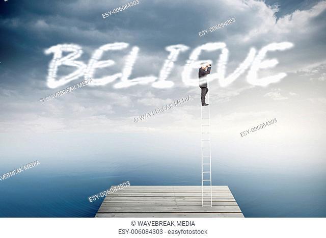 Believe against cloudy sky over ocean