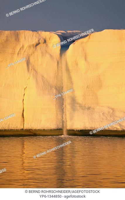 glacier Brasvellbreen with waterfall in sunset light, Nordaustlandet, Svalbard