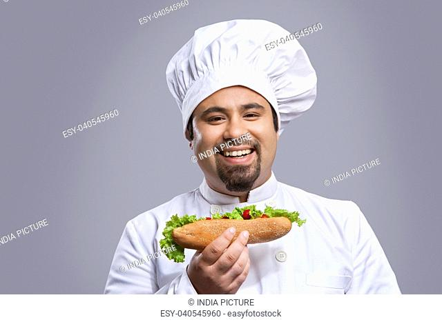 Portrait of chef with sandwich smiling