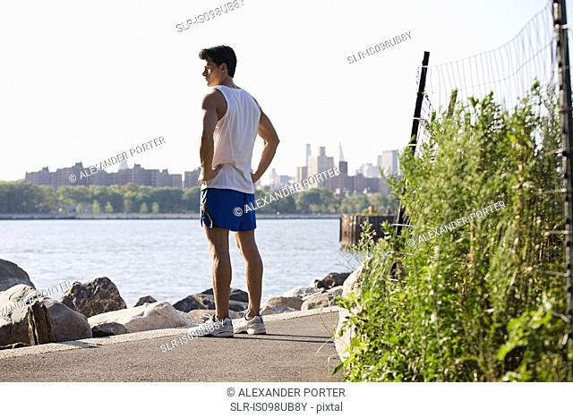 Male runner by river