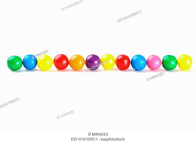 Colorful gumballs border over white background