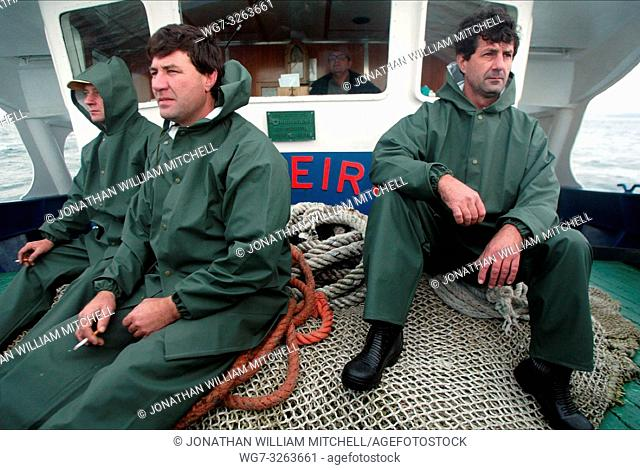 SPAIN Ria de Arousa -- 03/12/2002 -- Local fishermen set off in their boat to look for fuel from the sunken tanker Prestige