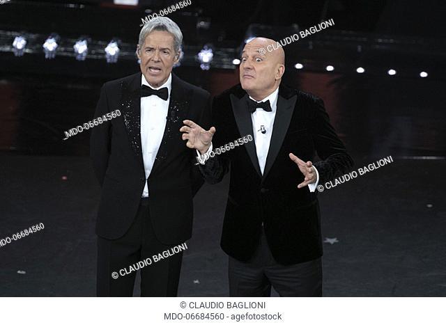 Italian presenter and singer Claudio Baglioni and Italian presenter and comic Claudio Bisio during the second evening of the 69th Sanremo Music Festival