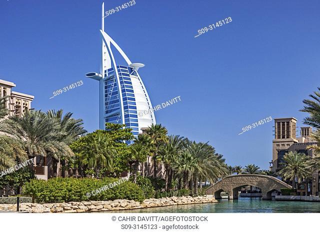 The waterways surrounding the Madinat Jumeirah 5 star hotel with the Luxury 7 star Burj Al Arab hotel in the background, Jumeirah, Dubai, Dubayy