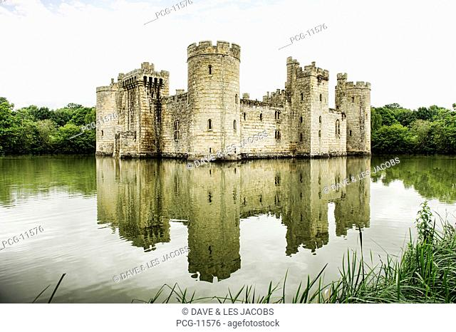 A medieval moated 14th century stone built castle, a fortified building