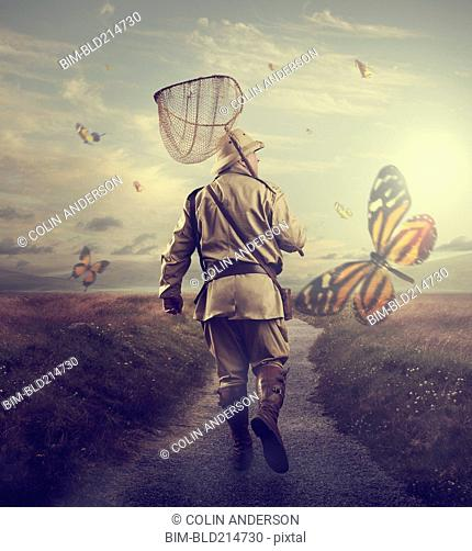 Hunter carrying butterfly net on remote path