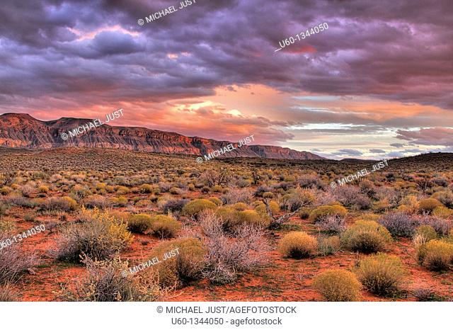 The sun sets on the cliffs bordering Sand hollow in Southern Utah