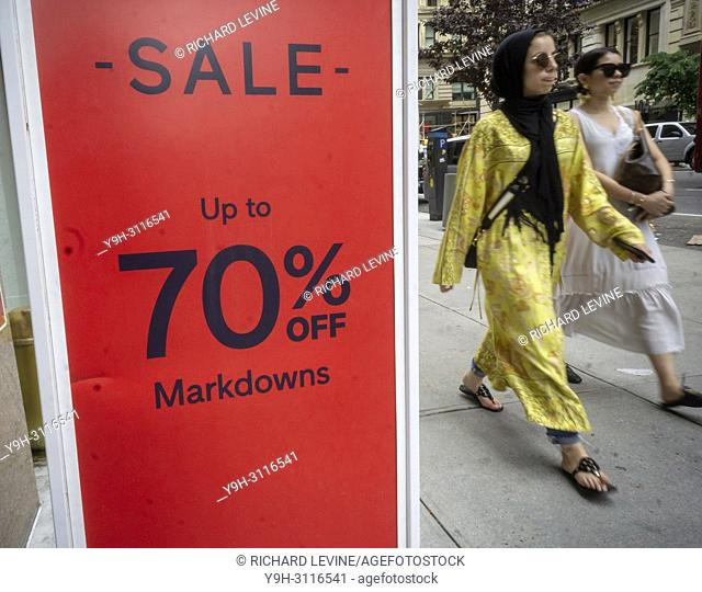 A sign in the Gap in New York on Sunday, July 15, 2018 advertises up to 70% off on merchandise in the chain's store. (© Richard B. Levine)