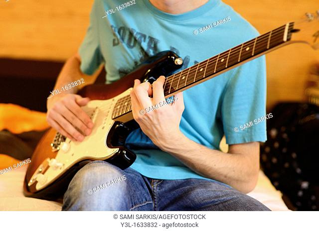 Playing Electric Guitar Bed Stock Photos And Images Age Fotostock