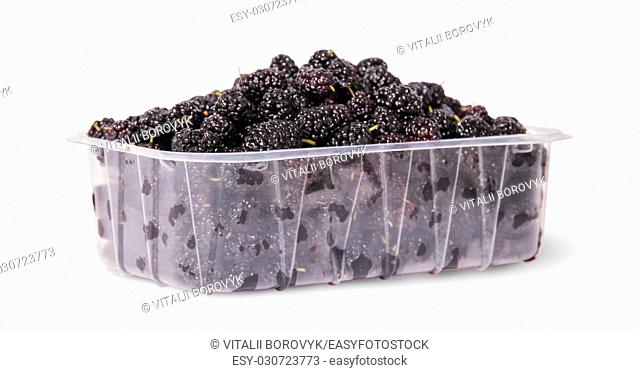 Mulberry in a plastic tray rotated isolated on white background