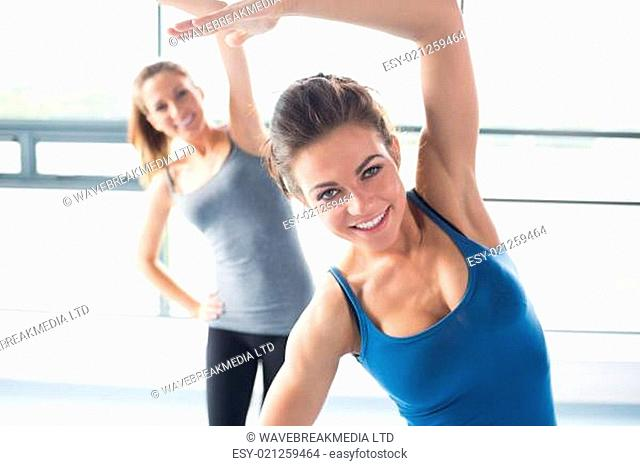 Women stretching their arms in the gym