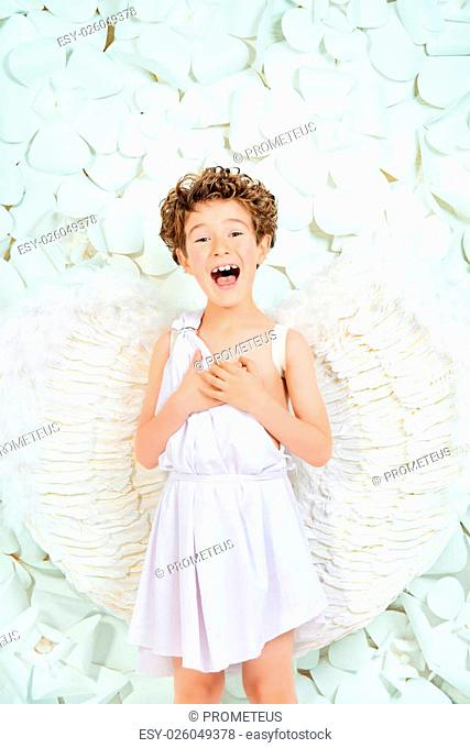 Portrait of a lovely emotional little boy in a costume of angel. Cupid. Valentine's day