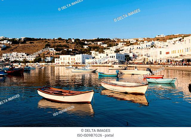 Boats by pier, town in background, Mykonos Town, Cyclades, Greece