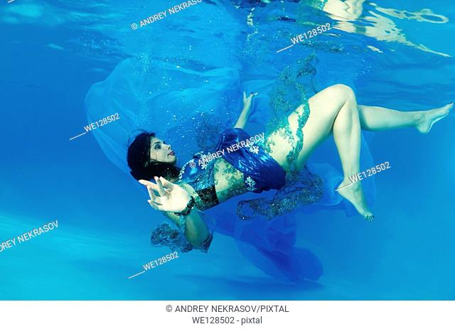 Woman presenting underwater fashion in a pool