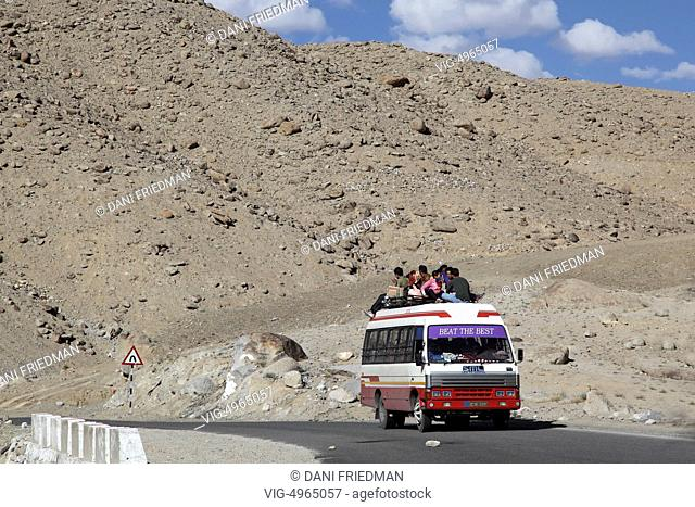 INDIA, NIMMU, 07.07.2014, Ladakhi Buddhist pilgrims travel on top an overloaded bus from the town of Saspool to the city of Leh to listen to His Holiness the...