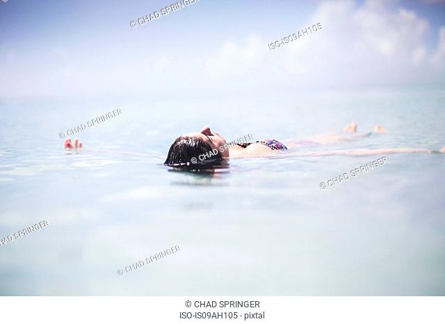 Woman floating in the sea