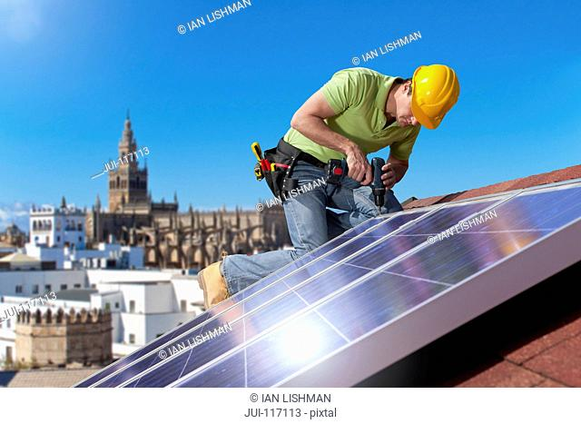 Engineer Fitting Solar Panels To Roof Of House