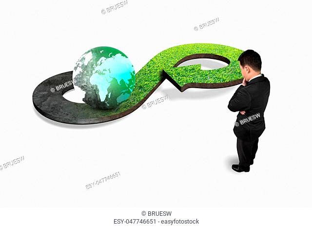 Green circular economy concept. Man looking at arrow infinity symbol with grass texture and colorful globe, isolated on white