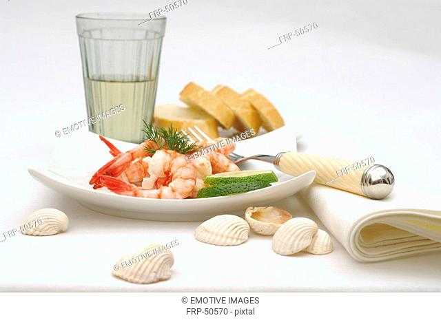 Glass, white bread and shrimps