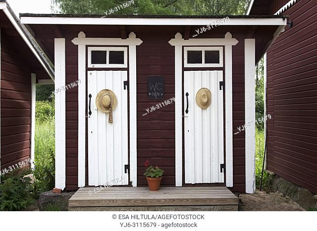 old outhouse with two doors, for male and female