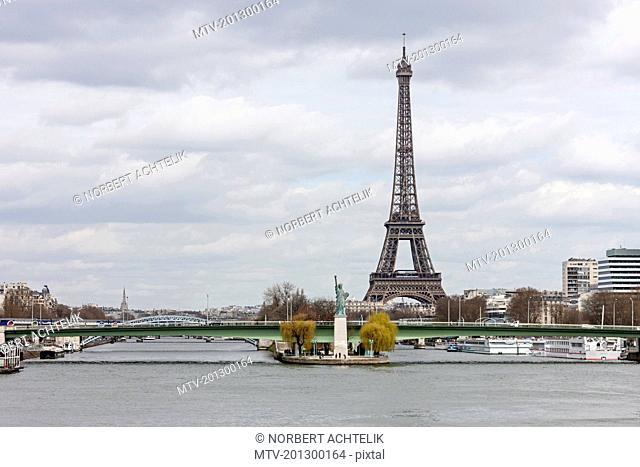 Replica of Statue of Liberty near Pont Grenelle with Eiffel Tower in background, Paris, France