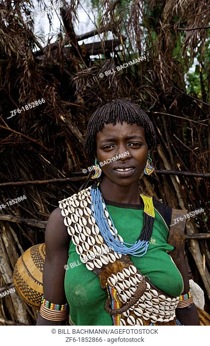 Key Afer Ethiopia Africa village Lower Omo Valley closeup of a Hamar or Hammer woman traditional outfits and red hair portrait 14