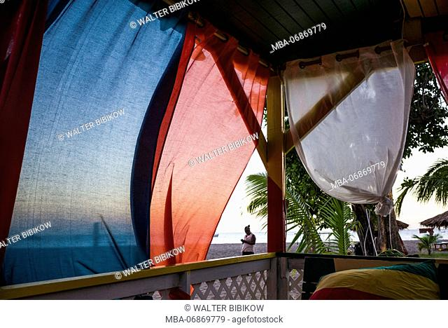 St. Kitts and Nevis, Nevis, Pinneys Beach, beach lounge with curtains