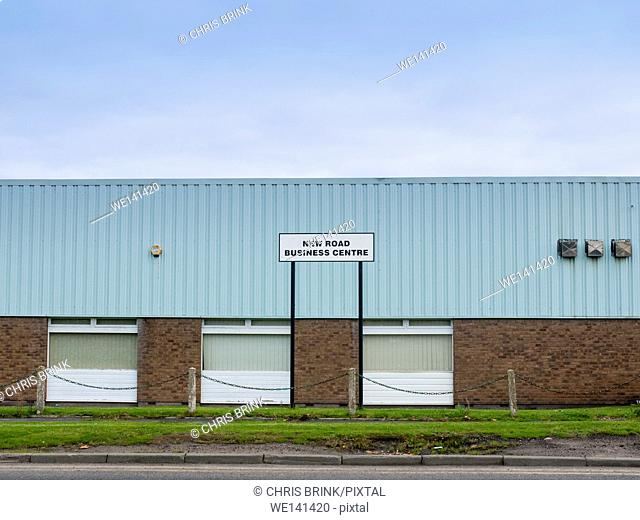 New Road Business Centre sign on a industrial estate with warehouse in Cheshire, UK