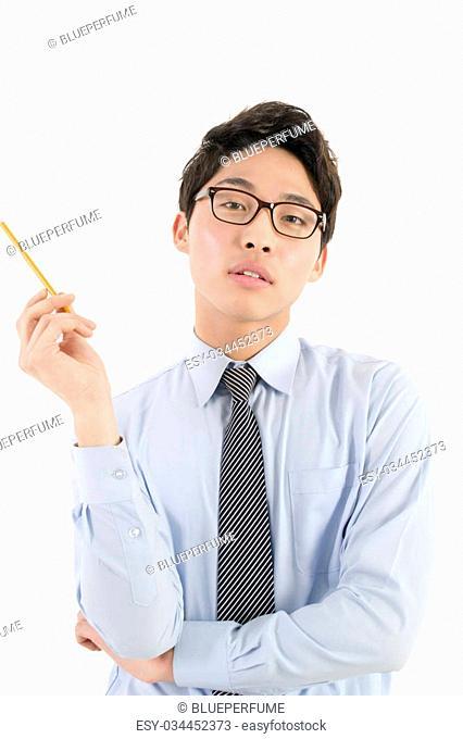 Asian male teacher with a pencil, studio shot