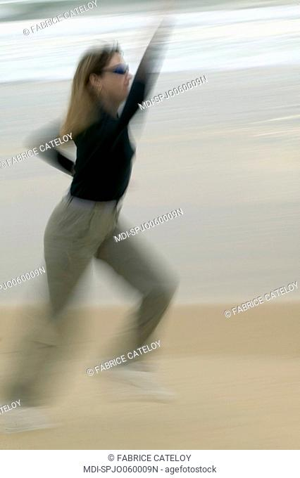 Woman running on a beach