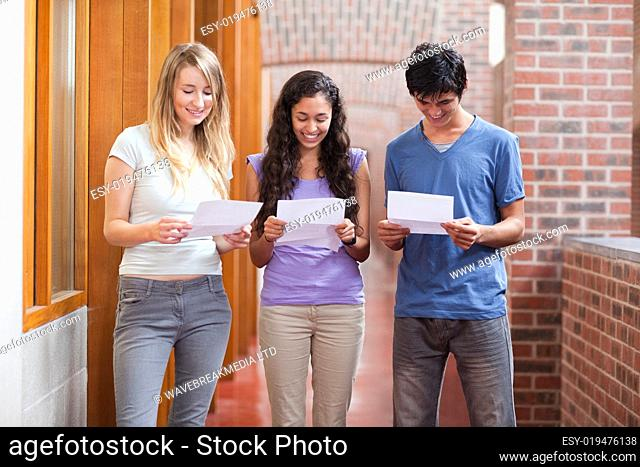 Students reading a piece of paper
