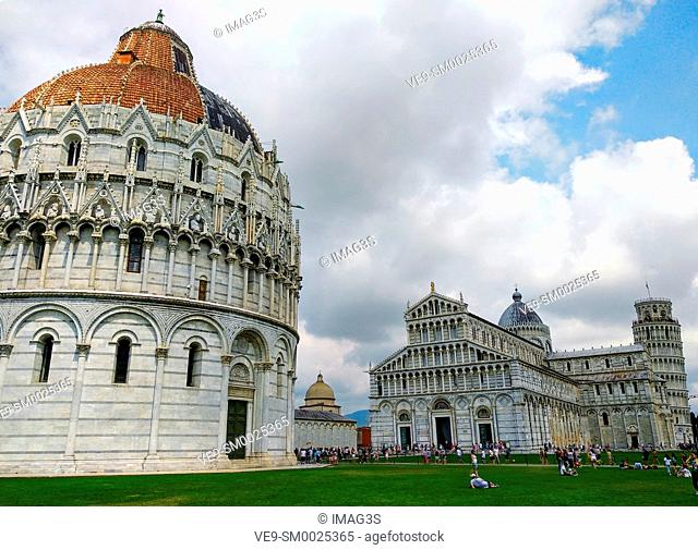 Baptistery of St. John and Pisa Cathedral in background, Piazza dei Miracoli, PIsa, Italy