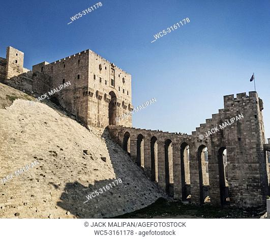 famous ancient citadel fortress gate landmark in central old aleppo city syria by day