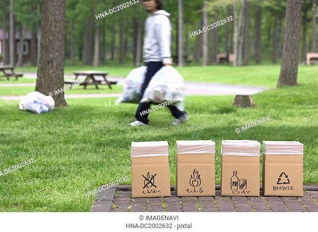 Man with Trash Bag Walking