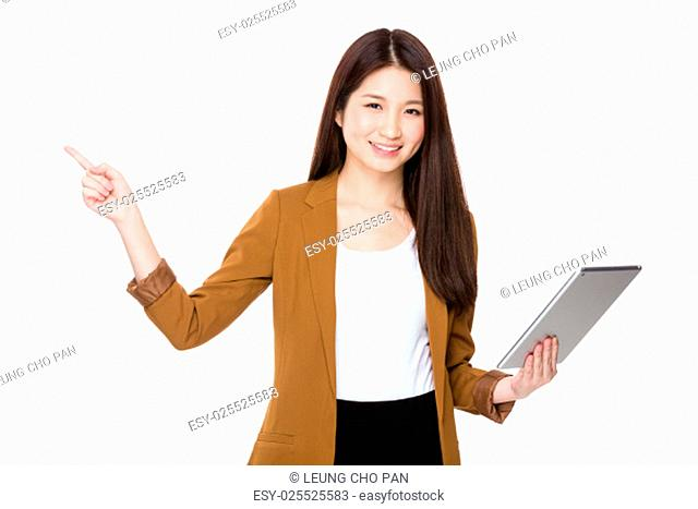 Asian young businesswoman use of tablet pc and finger point up