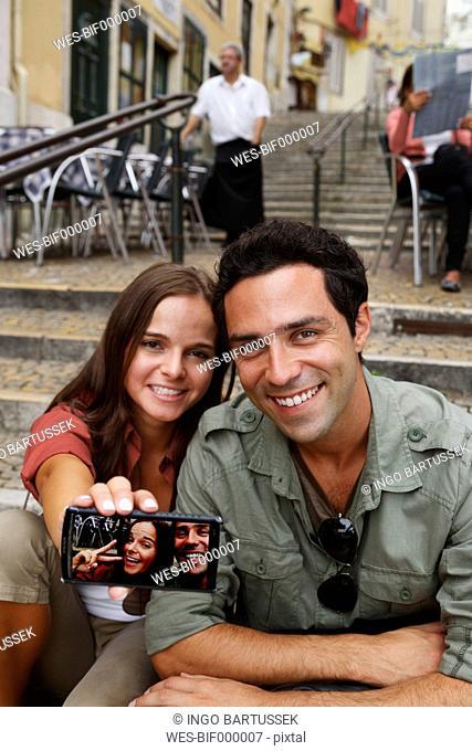 Portugal, Lisboa, Carmo, Calcada du Duque, young couple presenting self portrait