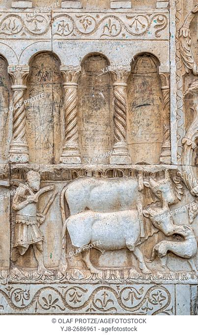 Detail from the reliefs depicting the Life of St Peter and medieval stories from the 12th century at the facade of Church of St Peter (Chiesa San Pietro)