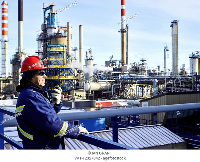 Tradesman working at a refinery; Edmonton, Alberta, Canada