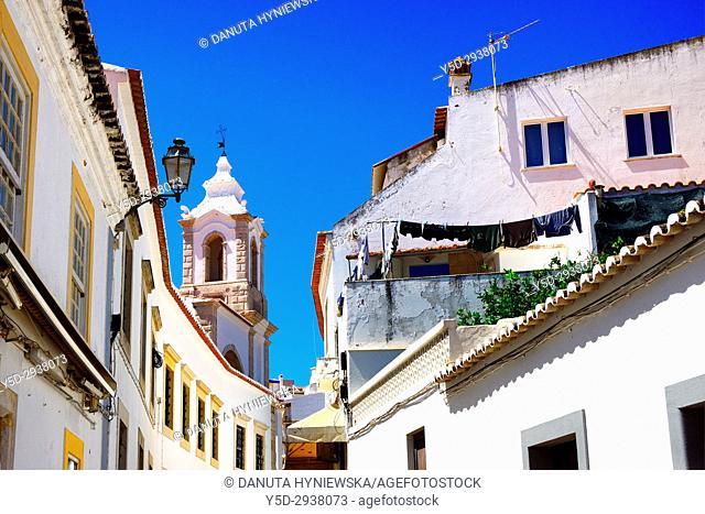 Rua Henrique Correia da Silva, belltower of Santo António church in background, historic old town of Lagos, Algarve, Portugal, Europe