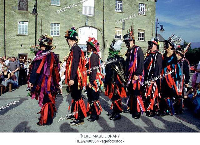 Morris dancers, Sowerby Bridge Rushbearing Festival, West Yorkshire. Held on the first weekend of September, the rushbearing festival celebrates the tradition...