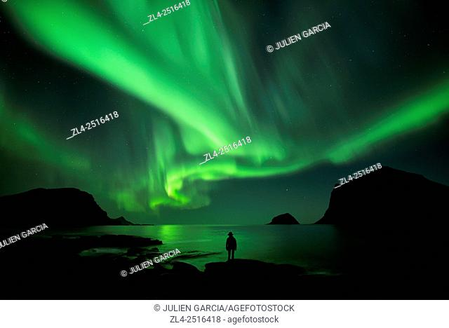 Norway, Nordland, Lofoten islands, Vestvagoy island, Vik beach, silhouette of a woman and northern lights (aurora borealis), Model Released